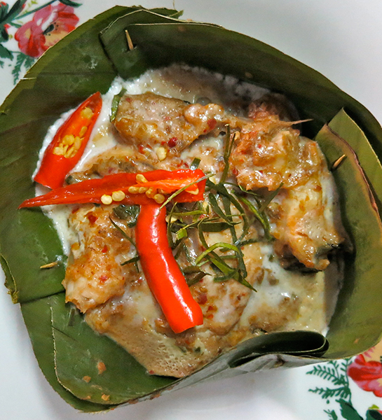 Mok Plaa Suai - Suai fish wrapped in banana leaf and wood-charred.